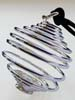 Tuotekuva: Hopeanvärinen spiraali kiville